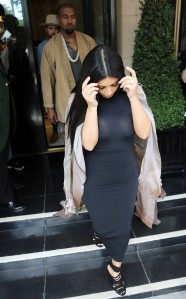 51783899 Pregnant reality star Kim Kardashian and her husband Kanye West leave the Dorchester Hotel in London, England and catch a helicopter out of Denham Airfield on June 27, 2015. Kim left little to the imagination in her form fitting, see through black dress. The pair are flying into Glastonbury where Kanye is headlining tonight. FameFlynet, Inc - Beverly Hills, CA, USA - +1 (818) 307-4813 RESTRICTIONS APPLY: USA ONLY