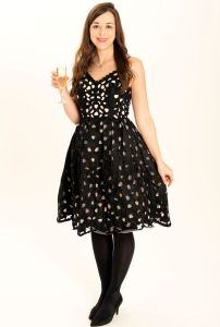 Emily-Retter-tries-out-a-selection-of-party-dresses-on-sale-for-one-pound