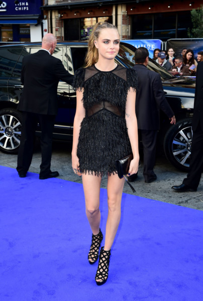 d6492346 Cara Delevingne in a little black fringed and sequin number. attending the  world premiere of